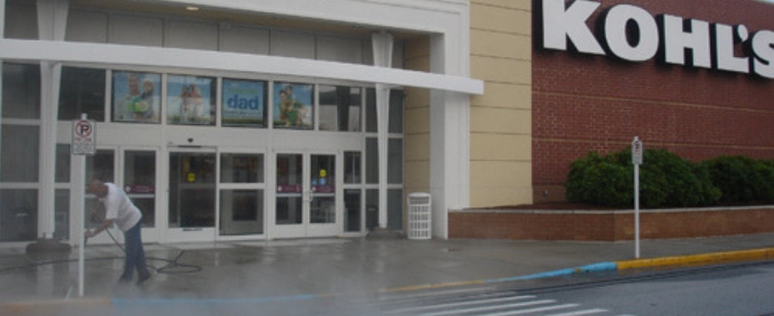 Image of a Kohl's retail store entrance being professional power washed.