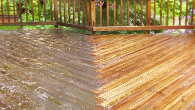 Photo of a deck half way through a pressure washing service.