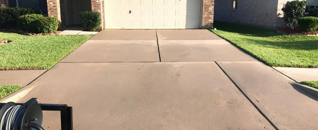 Photograph of a driveway that has just been pressure washed.