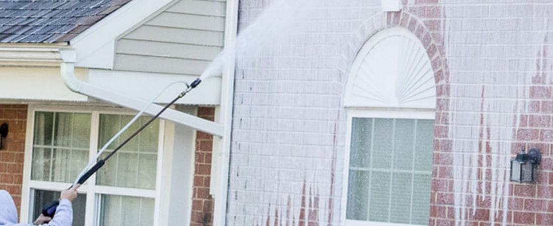 House in the middle of a soft wash exterior cleaning service by Strong Arm Pressure Washing in Gwinnett County, GA.