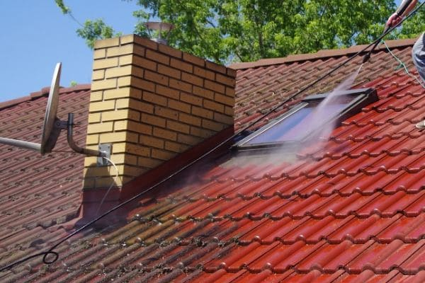 Roof in the process of being power washed.